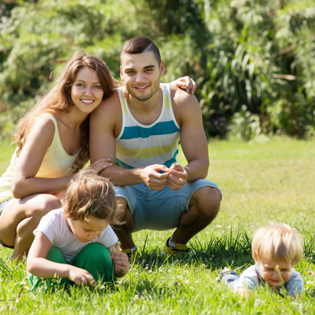 """Family of four in sunny park"" stock image"