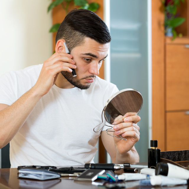 """Shorter hair with a trimmer"" stock image"