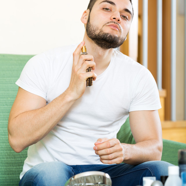 """Handsome man applying perfum"" stock image"