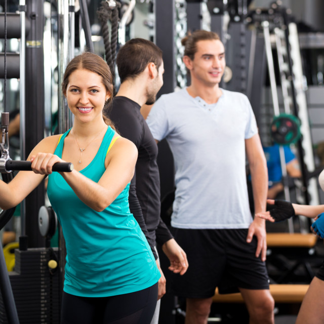 """Active people having weightlifting training"" stock image"