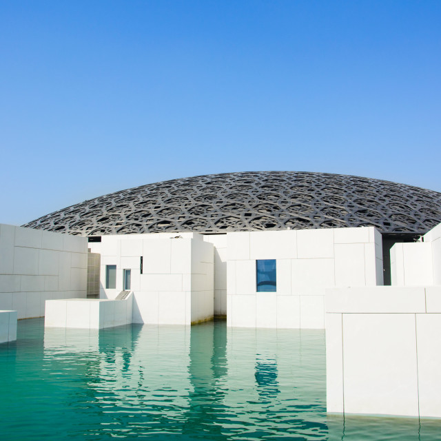 """Louvre Abu Dhabi building exterior on a sunny day"" stock image"