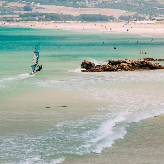 """People resting at beach in Tarifa, Spain."" stock image"
