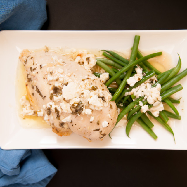 """""""greek chicken with feta and green beans"""" stock image"""