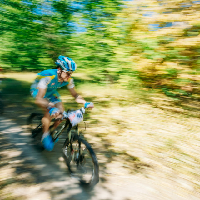 """""""Abstract motions blur background - mountain Bike cyclist riding track at..."""" stock image"""