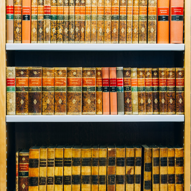 """""""Old 19th century Russian Vintage Books stand in a row on shelf In The..."""" stock image"""