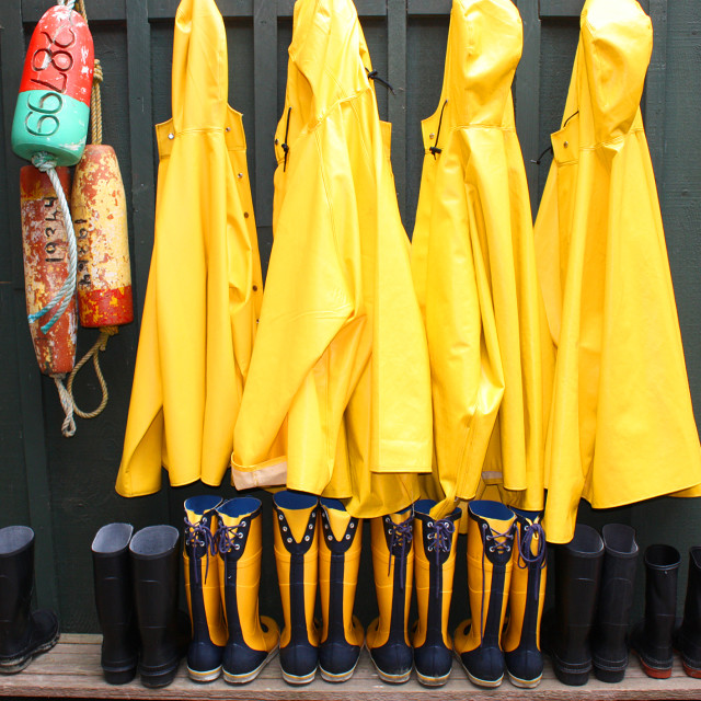 """Wellies and Raincoats, Tofino Harbour"" stock image"