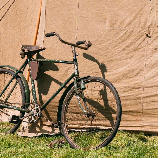 """Old Bicycle Parked Next To Large Soviet Military Canvas Khaki Tent On Green..."" stock image"