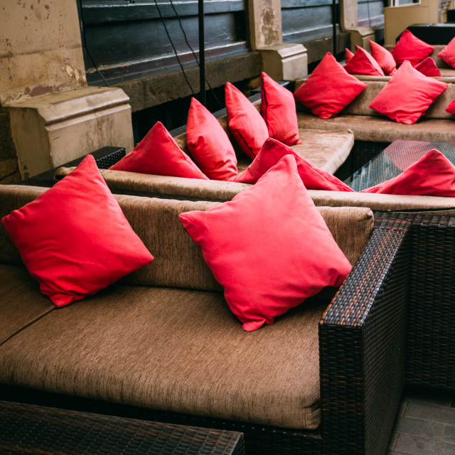 """Red Pillows Lie On Comfortable Sofas Street Cafes"" stock image"