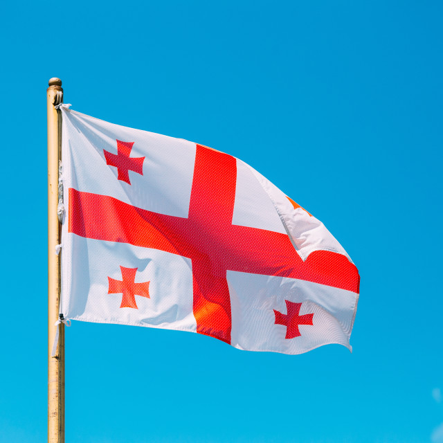 """Close Flag Of Georgia Five Cross Flag Waving At Blue Sunny Sky Background...."" stock image"