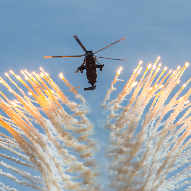 """Royal Navy Sea King with flares"" stock image"