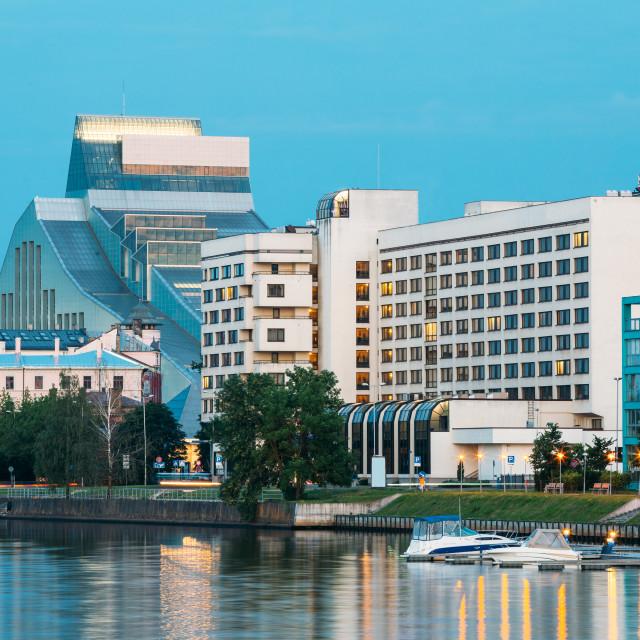 """Riga Latvia. Evening Cityscape At Bank Of Daugava River With National..."" stock image"