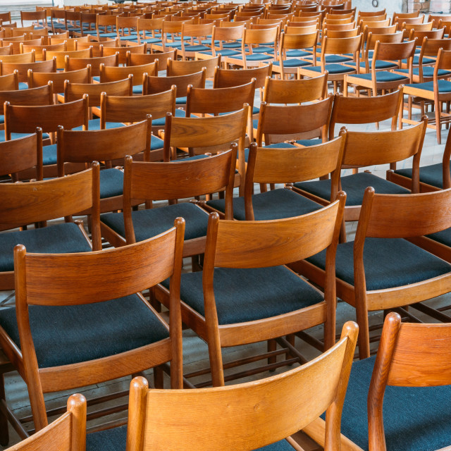 """""""Many Empty Wooden Chairs With Backrest, Blue Upholstery Standing In Neat Rows..."""" stock image"""