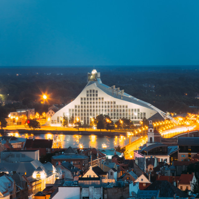 """""""Riga, Latvia. Aerial View Of Cityscape In Summer Evening Or Night Lights..."""" stock image"""