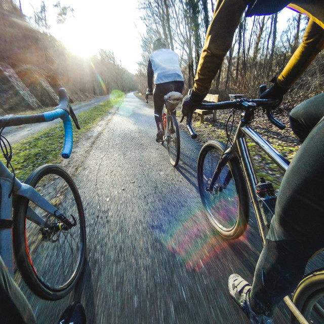 """Three Riders Cycling On A Greenway"" stock image"