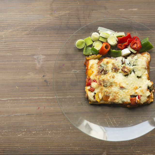 """""""Lasagna with vegetables in a glass dish."""" stock image"""
