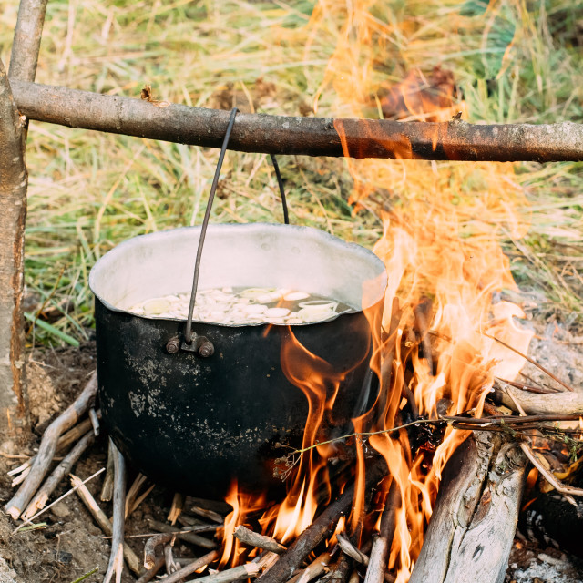 """""""Old Camp Saucepan Boiled Water For Soup Preparation On A Fire In Forest...."""" stock image"""