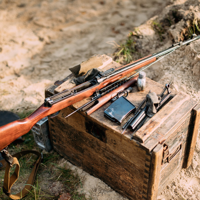 """""""Old Soviet Russian Disassembled Sks Semi-automatic Carbine On A Wooden Box...."""" stock image"""