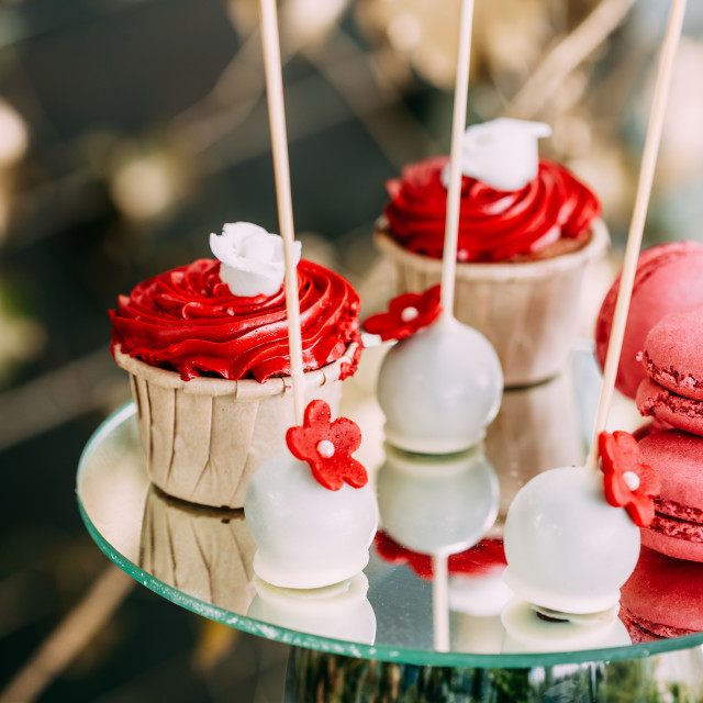 """Dessert Sweet Tasty Cupcakes And Macarons In Candy Bar On Table. Delicious..."" stock image"