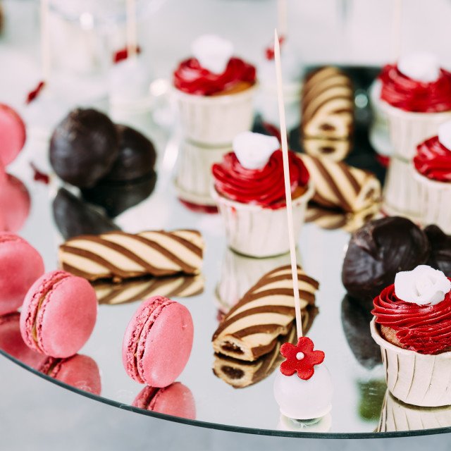 """""""Dessert Sweet Tasty Cupcakes, Macarons And Cookies In Candy Bar On Table...."""" stock image"""