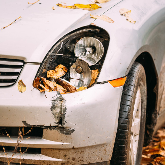 """Broken Lamp Headlight And Bumper Car Scratched With Deep Damage To Paint"" stock image"