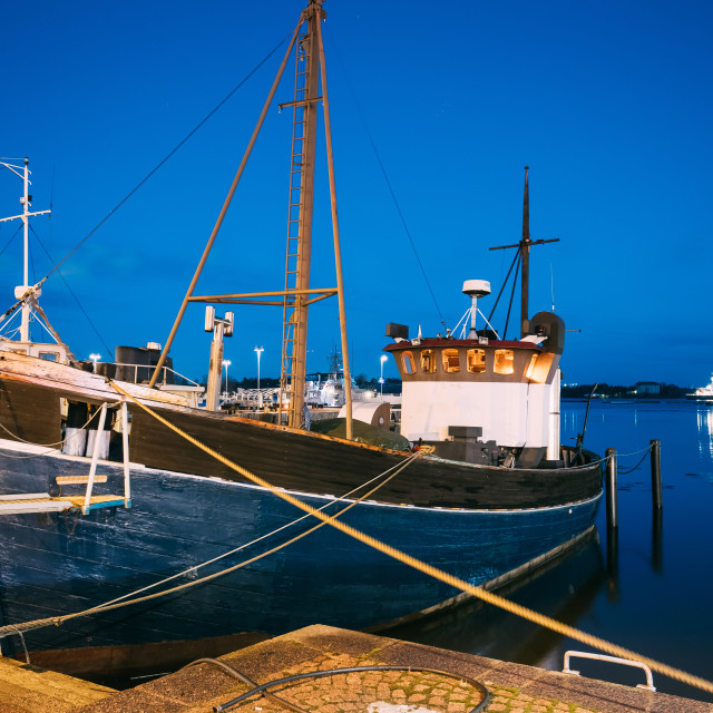 """""""Helsinki, Finland. View Of Fishing Marine Boat, Powerboat At Pier In Evening..."""" stock image"""