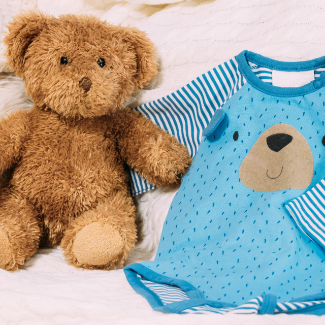 """""""Toy Bear Near Child's Clothes Rompers."""" stock image"""