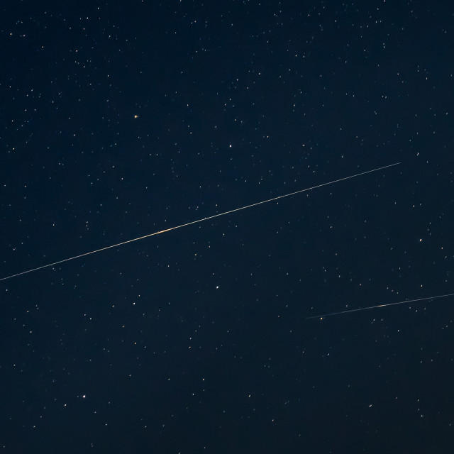 """""""Two Meteoric Tracks In The Blue Night Starry Sky Background. Natural Glowing..."""" stock image"""