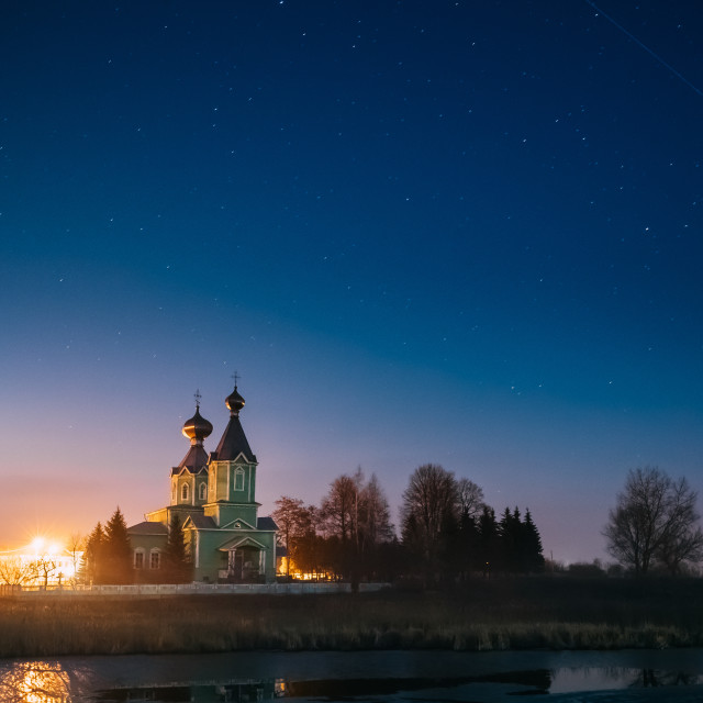 """""""Old Russian Wooden Orthodox Church Of The Holy Trinity Under Night Starry Sky..."""" stock image"""