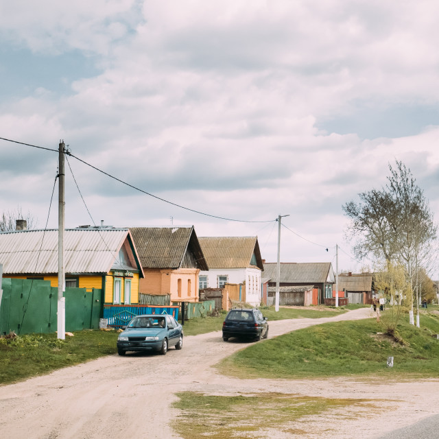 """""""Car Parking On Country Road On A Background Of Traditional Old Wooden Village..."""" stock image"""