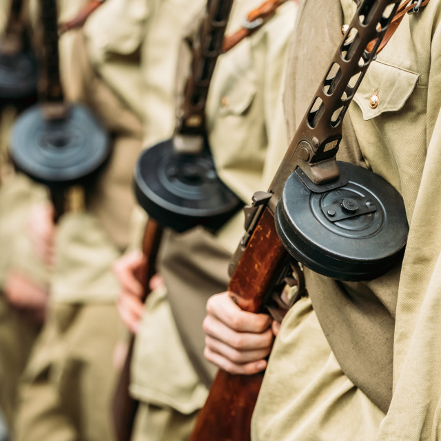 """""""Re-enactos Dressed As Russian Soviet Soldiers Of World War II Holds..."""" stock image"""