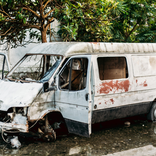 """Old Broken Crashed Rusty Minibus Car Abandoned In City"" stock image"