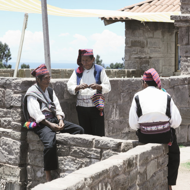 """Three men dressed in traditional outfits specific for the Taquile Island region"" stock image"