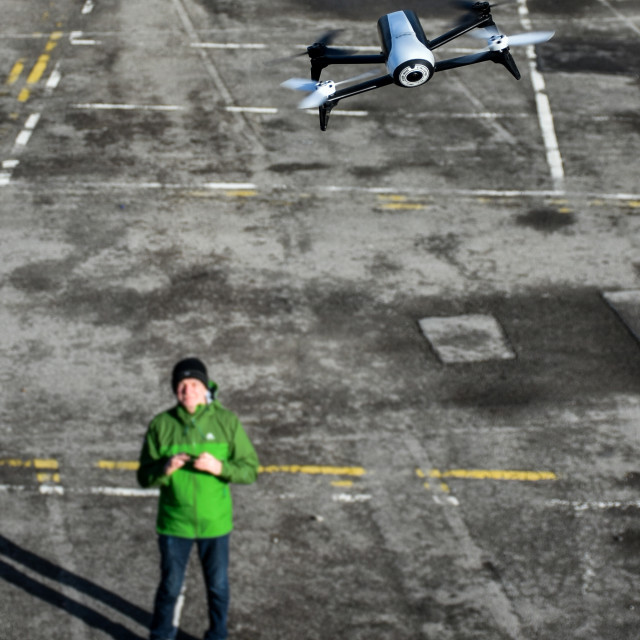 """Man flying a Drone"" stock image"