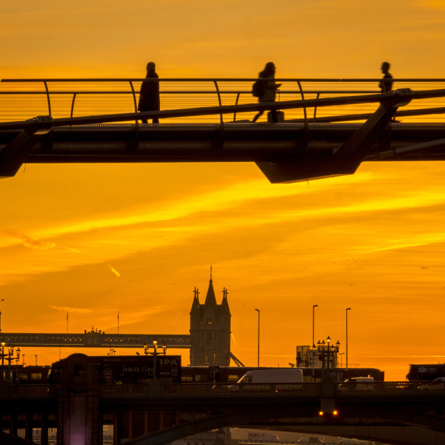 """Commuters on Millennium Bridge at Sunrise, London"" stock image"