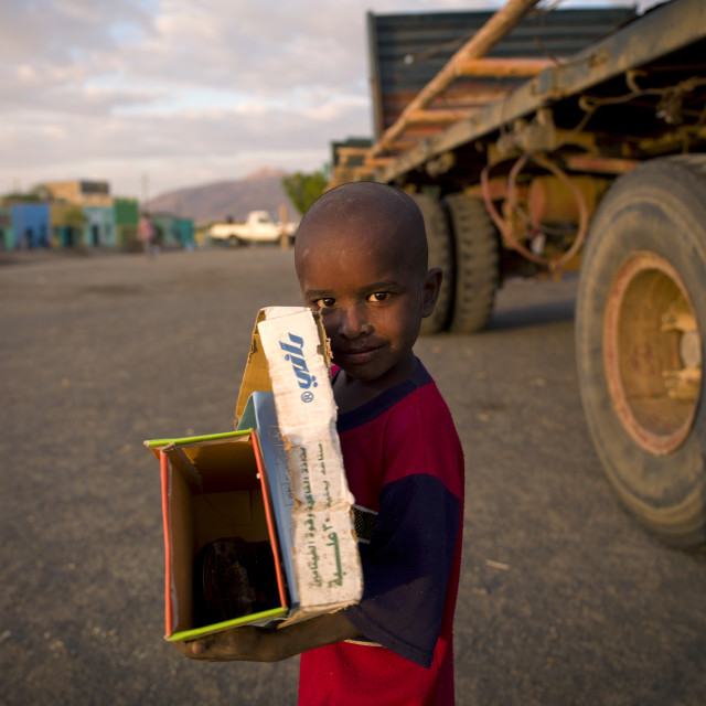 """Boy Collecting Boxes In The Street, Assaita, Ethiopia"" stock image"
