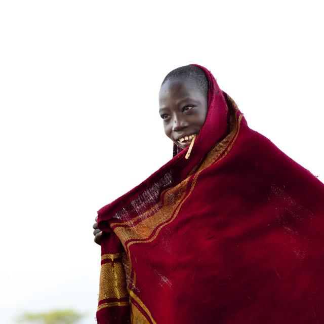 """Bodi Teenage Boy Chewing Siwak Stick In Red Loincloth Ethiopia"" stock image"