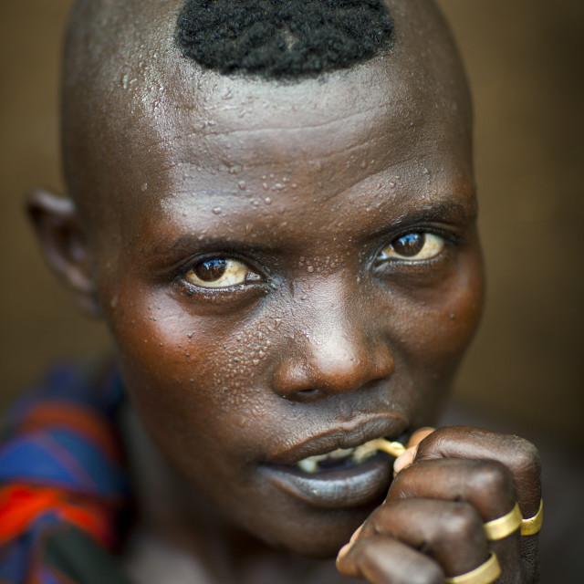 """Bodi Tribe Woman Chewing A Stick, Hana Mursi, Omo Valley, Ethiopia"" stock image"
