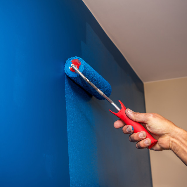 """""""workman painting the wall in blue."""" stock image"""