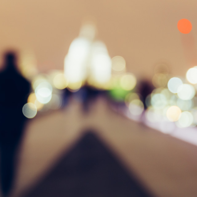 """London blurred people walking by skyline at night"" stock image"