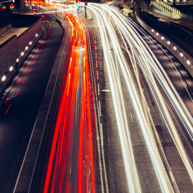 """City light trails of fast moving traffic on road in London at ni"" stock image"