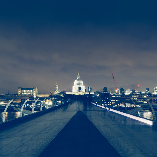 """Long exposure on Millennium Bridge at night on London skyline"" stock image"