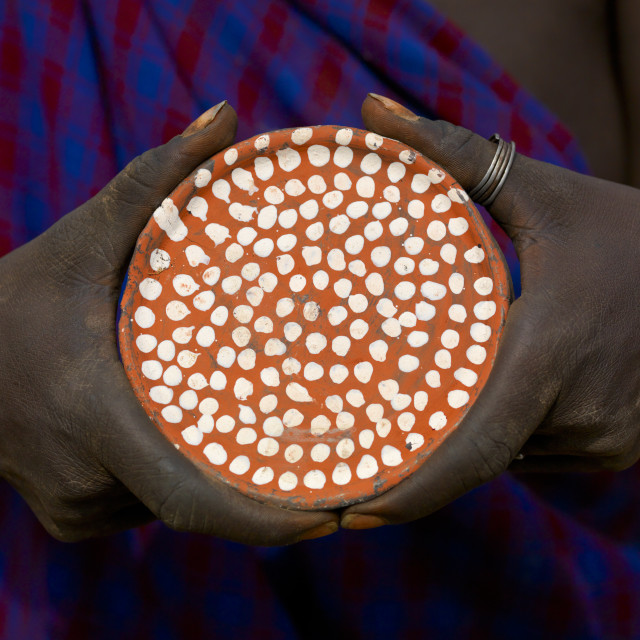 """""""Mursi Tribe Woman Holding A Clay Lip Plate With White Dots, Omo Valley,..."""" stock image"""