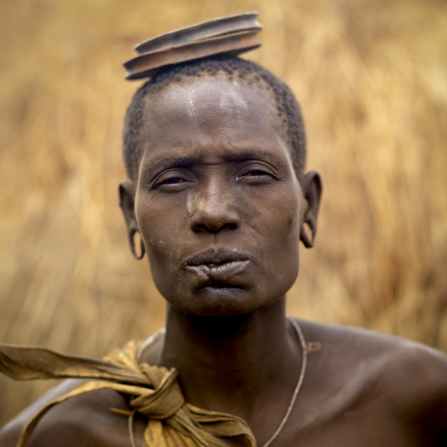 """""""Mursi Woman Whose Inferior Lip Was Cut Carrying Two Clay Lip Plates On His..."""" stock image"""
