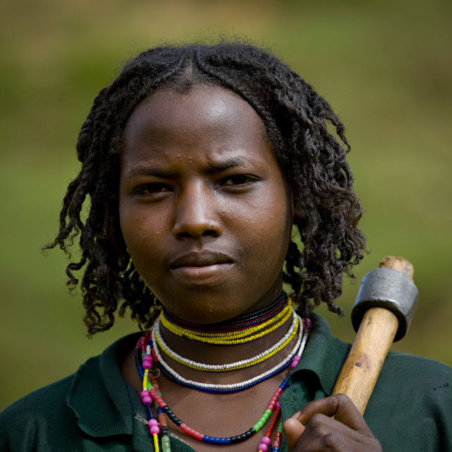 """Portrait Of Young Borana Tribe Woman Carrying Axe And Beaded Jewels, Omo..."" stock image"