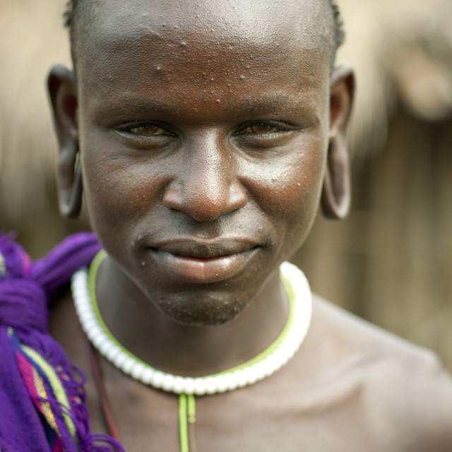 """""""Young Surma Woman With Extended Ear Lobes Tricky Look Ethiopia"""" stock image"""
