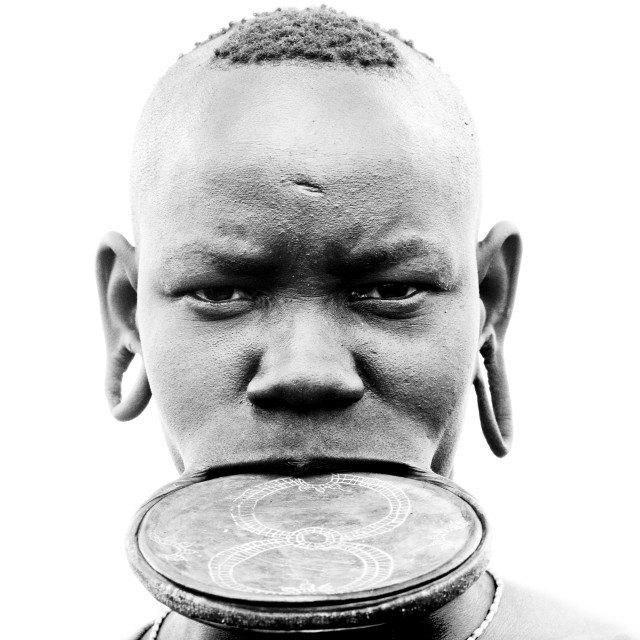 """""""Black And White Portrait Of A Mursi Tribe Woman With Lip Plate And Extended..."""" stock image"""