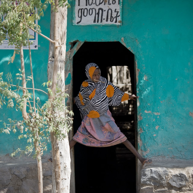 """""""Girl At The Entrance Of Her House, Assaita, Afar Regional State, Ethiopia"""" stock image"""