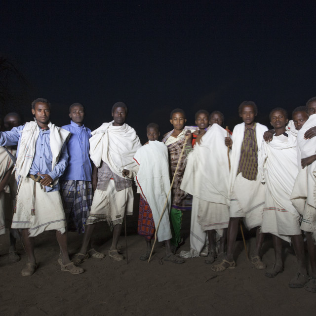 """Night Shot Of A Group Of Karrayyu Tribe Men Standing Proud During Gadaaa..."" stock image"