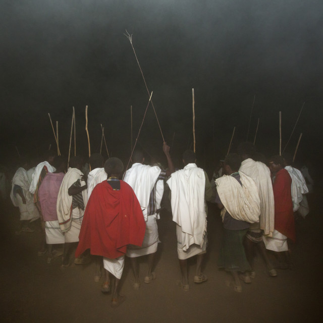 """Rear View Of A Group Of Karrayyu Tribe Men In A Cloud Of Dust During Gadaaa..."" stock image"