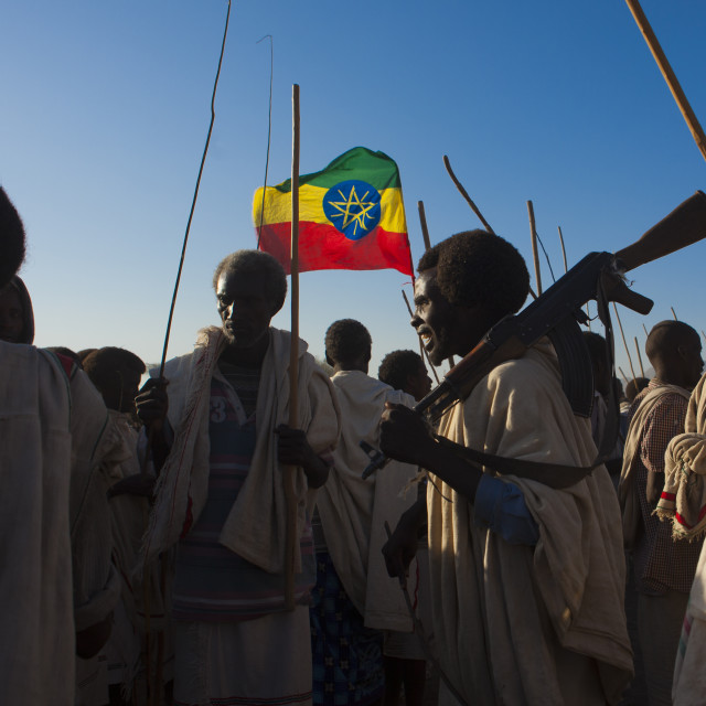 """Ethiopian Flag Floating Above A Group Of Karrayyu Tribe Men, One Carrying A..."" stock image"